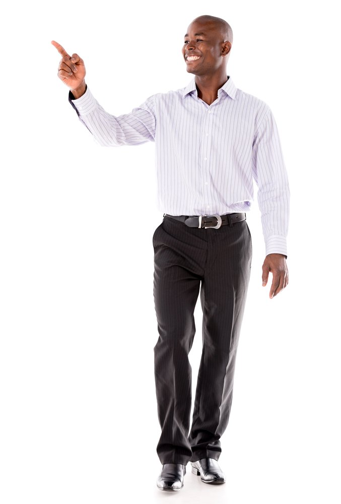 Happy business man pointing to the side - isolated over white